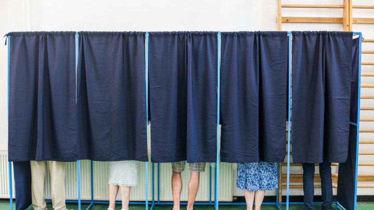 People in voting booth (c) Stock Photo